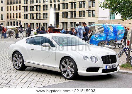 Berlin, Germany - September 12, 2013: Motor car Bentley Continental GT in the city street.