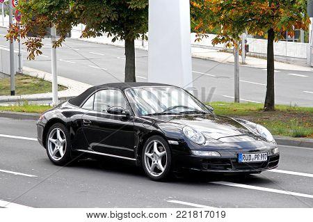 Frankfurt am Main, Germany - September 13, 2013: Motor car Porsche 911 (991) in the city street.