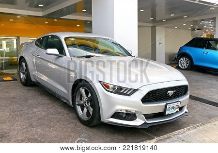 Cancun, Mexico - June 5, 2017: Motor car Ford Mustang in the city street.