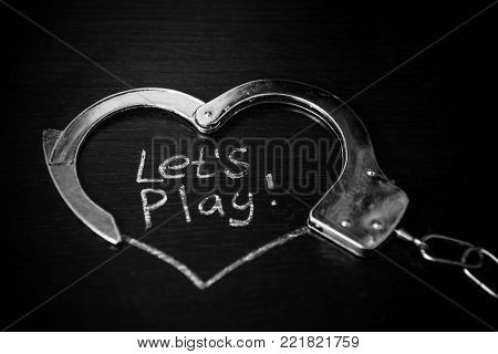 Lets play bdsm. Handcuffs with caption. Role play game