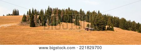 Abandoned log cabin homestead in the Central Rocky Mountains of Montana United States