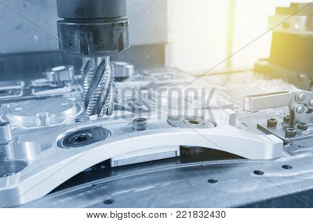 The CNC milling machine cutting the automotive part with the rough end Mill tool .Hi-precision CNC machining concept.