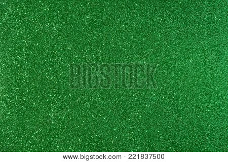 Shiny glimmering green texture