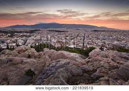 View of Athens from Filopappou hill at sunrise, Greece.