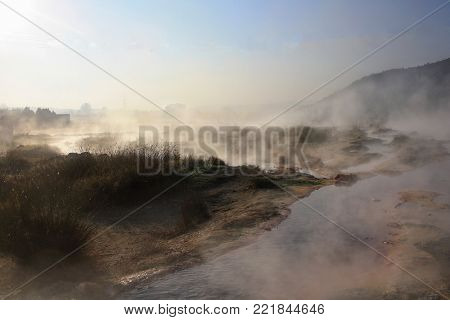 Hot springs with mineral water in Rupite, near Petrich, Bulgaria; steam is coming from hot water springs in the morning