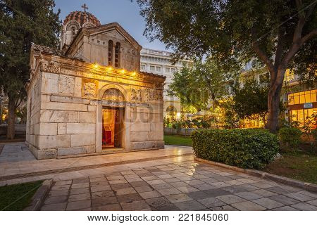 ATHENS, GREECE - JANUARY 9, 2018: Historic Byzantine-era church with stone carvings on the exterior walls located in Metropolis square in the old town of Athens on January 9, 2018.