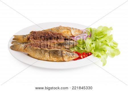 Deep-fried Sea Bass in Fish Sauce isolated on white background.