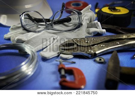 Safety glasses and othe tools on a working table