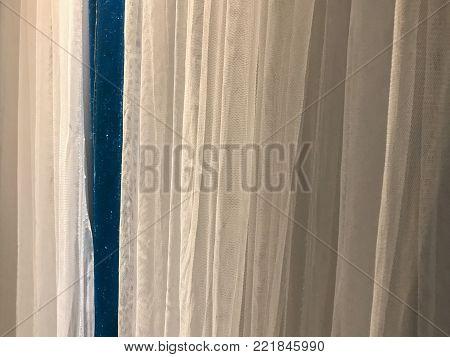 behind white curtain stage scene at thailand