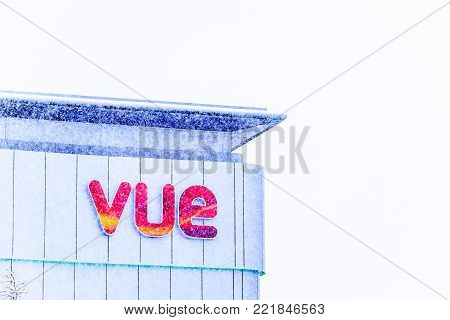 Northampton UK December 09, 2017: VUE entertainment logo sign in Northampton town centre under snow fall.