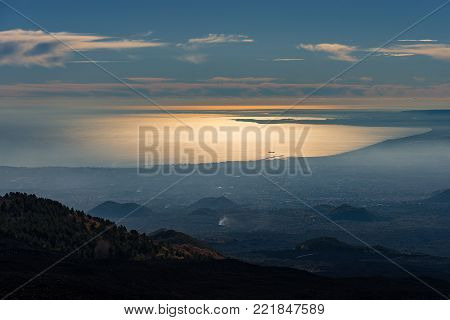 Catania city and Mediterranean Sea - Overview from Mount Etna Volcano. Sicily island, Italy (Sicilia, Italia) Europe