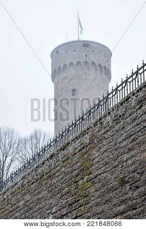 Toompeas Castle tower on Toompea hill in the central part of Tallinn, Estonia. The fog and drizzle gives a sense of mystery for the tower