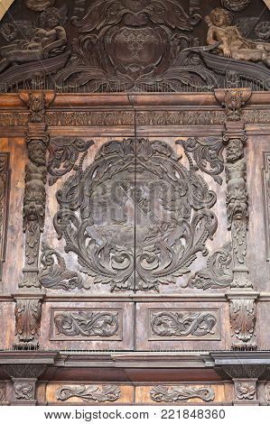 WROCLAW - POLAND, JULY 12, 2017:  Wroclaw Cathedral (Cathedral of St. John the Baptist), gothic style 13th century church on Ostrow Tumski Island, wooden gate. It  is the seat of the Roman Catholic Archdiocese of Wroclaw