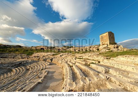 Ancient Greek Roman theater at sunset in Syracuse city (Siracusa), Sicily island, Italy, Europe (V century BC)