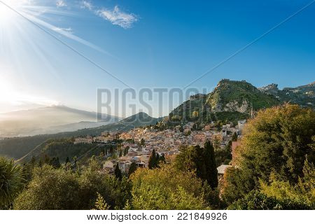 The Taormina town and The mount Etna Volcano with smoke, Messina, Sicily island, Italy (Sicilia, Italia)