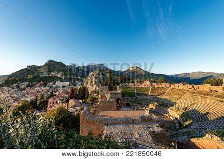 Ancient Greek Roman theater at sunset in Taormina town, Messina, Sicily island, Italy (II century AD)