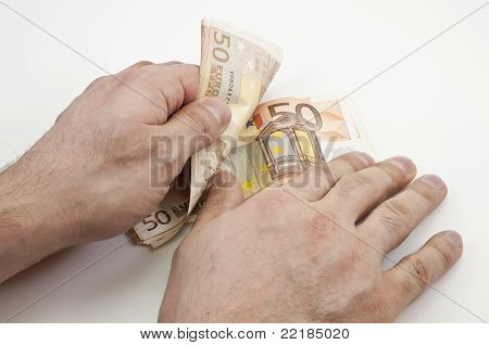 Two Hands Counting Fifty Euro Banknotes