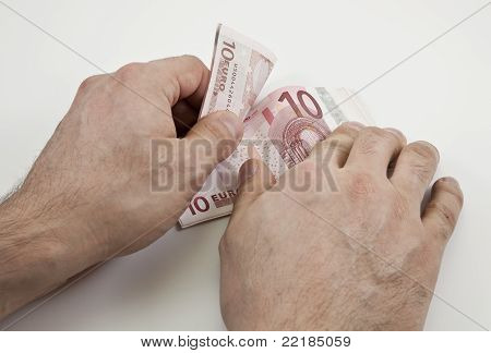 Two Hands Counting Ten Euro Banknotes
