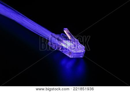 luminous fiber-optic lines and connector RJ-45. The concept of high-speed communication.