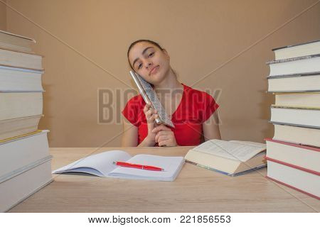 Thoughts, education, creativity concept. Portrait of pretty girl high school student. young attractive student Girl studying lessons