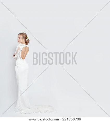 Young Bride In A Luxurious White Wedding Dress And Beautiful Hair. Woman Before The Wedding Ceremony