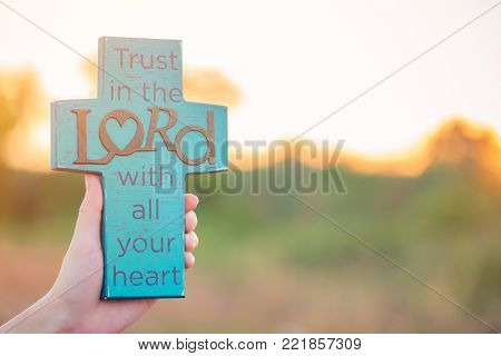 Bible Lettering On Blue Wooden Cross.trust The Lord With All Your Heart.