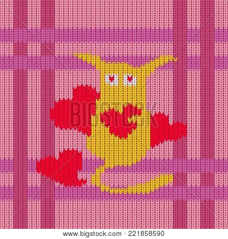 Strange yellow long-eared cute creature with red hearts on the seamless knitted pattern. Knitted woolen pattern of Valentine's Day