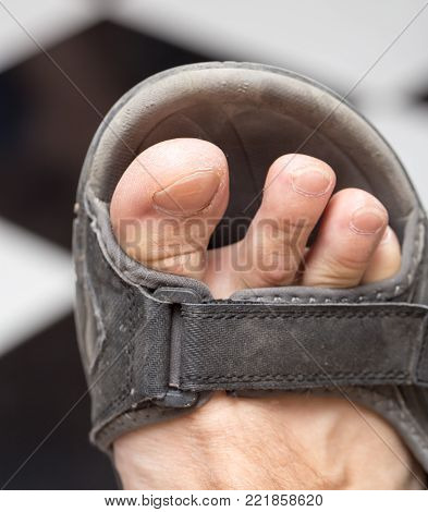 male foot in sandals . Photos in the studio