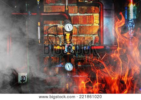 Fire, smoke and steam in a boiler room. Thermometers, pipes, valves and overheated chimney. Close up