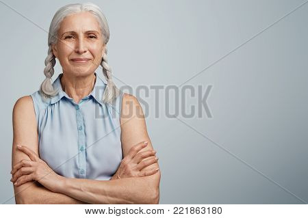 Isolated Shot Of Beautiful Mature Woman With Serious Expression, Looks Confidently At Camera, Keeps
