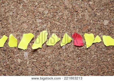 Lot of color paper scraps in a row on wooden background