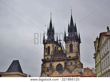 Three towers of the castle voyeurs over the roofs of houses in Prague. Czech Republic.