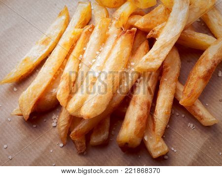Closeup of a french fries with salt