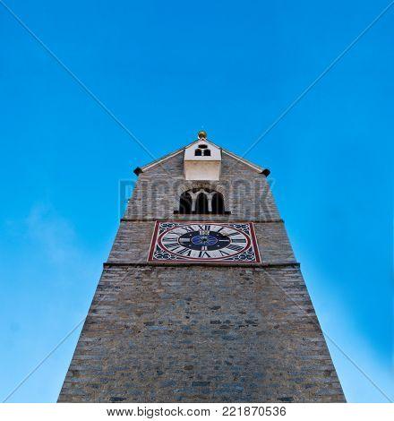 typical bell tower with clock of the churches of the mountains of central Europe