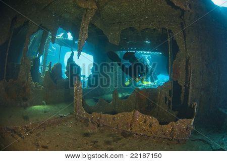 Divers Exploring A Large Shipwreck