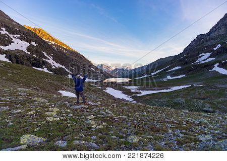 One Person Looking At Colorful Sunrise High Up In The Alps. Wide Angle View From Above With Glowing
