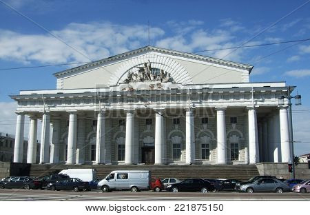 Saint Peterburg, Russia - JUNE 12, 2013: Stock exchange building and cars