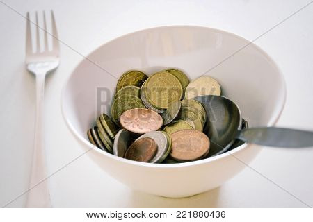 Ceramic bowl with money, saving and spending money concept