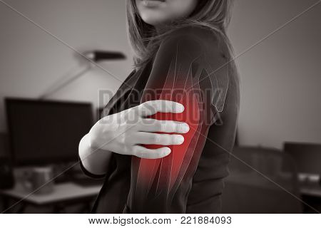 Asian businesswoman with upper arm pain against gray background, Office Syndrome, Woman with bone or muscles problem
