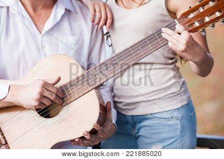 Playing guitar tutorial together concept. Individual courses. Lifestyle of talented people.
