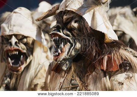 LUCERNE, SWITZERLAND - FEBRUARY 20, 2012: Unidentified people wear costumes and masks at Lucern Carnival in Lucerne, Switzerland.