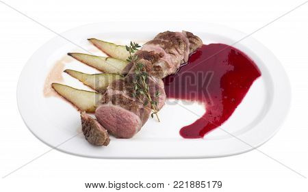 Duck breast with raspberry sauce and apple. Isolated on a white background.