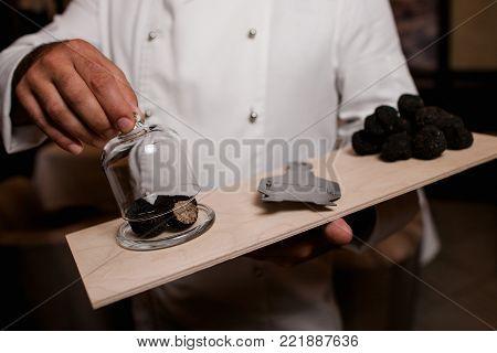 restaurant chef delicacy. truffle vegan food mushroom waiter service meal concept