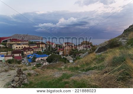 The top view of the resort town of Sudak on a cloudy evening. Crimea, the beginning of September.