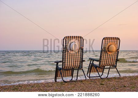 Deck chairs on a beach. Beach chairs on the seashore sand beach with clear sky.