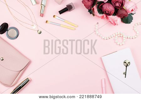 Fashion collection with accessories, flowers, cosmetics, purse and jewelry on pink background, copyspace. Womens Day concept, top view