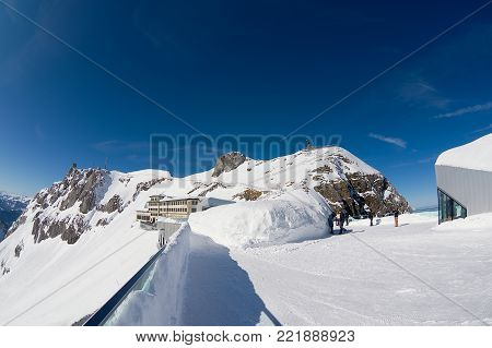 LUCERN, SWITZERLAND - FEBRUARY 21, 2012: Unidentified people enjoy the view from the terrace on top of the Pilatus mountain in Lucern, Switzerland.