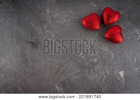 Red hearts on a gray background. The symbol of the day of lovers. Valentine's Day. Concept February 14