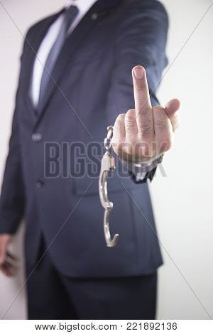 Hand of Businessman show fuck sign isolated on white background. justice - concept