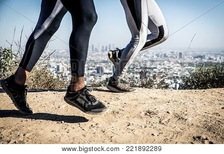 Couple Running In Los Angeles Canyons